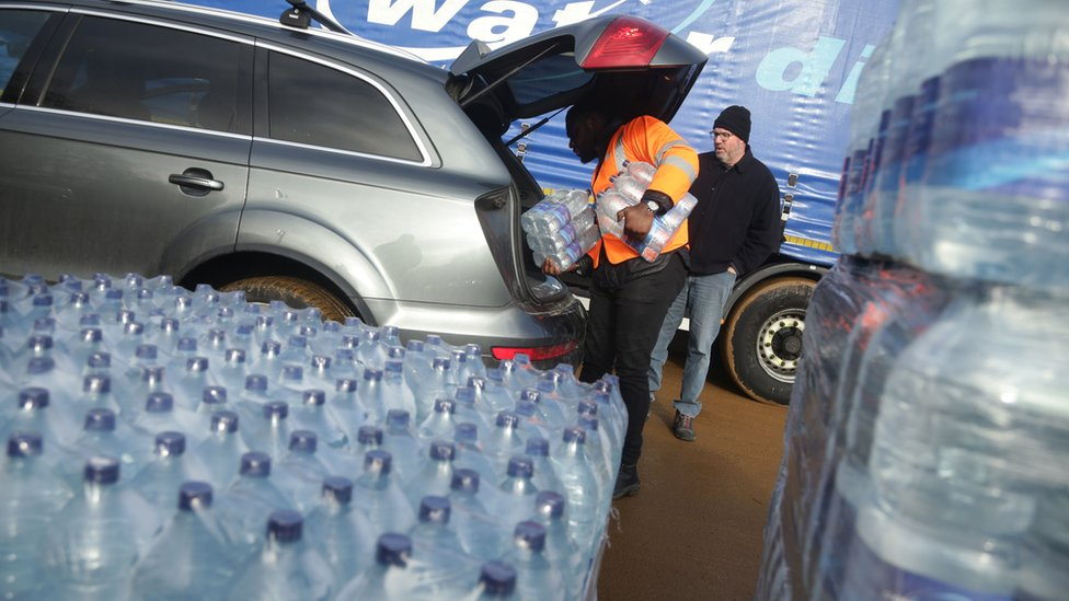 Water bottles loaded into car