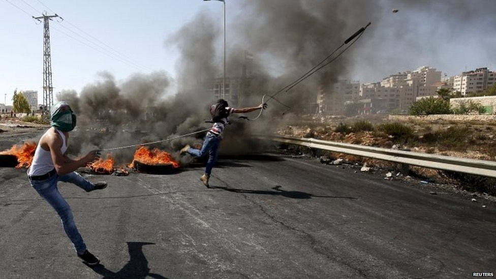 Palestinian protesters hurl stones at Israeli troops during clashes near the Jewish settlement of Beit El, near Ramallah in the West Bank 11/10/2105