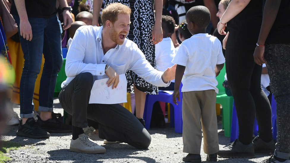 Prince Harry and a young boy in South Africa