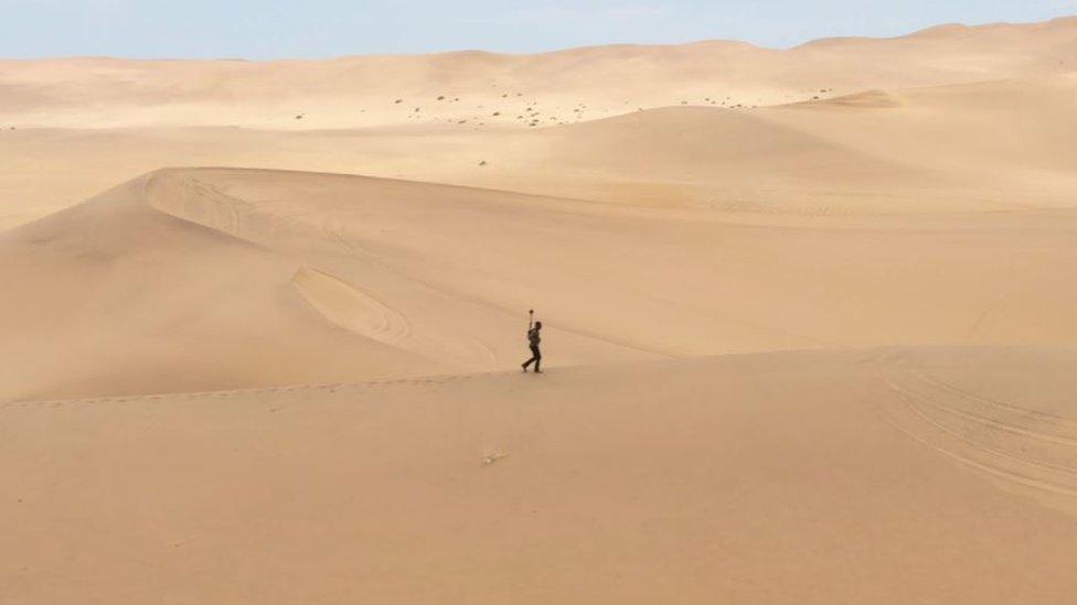 Tawanda mapping through a desert in Namibia