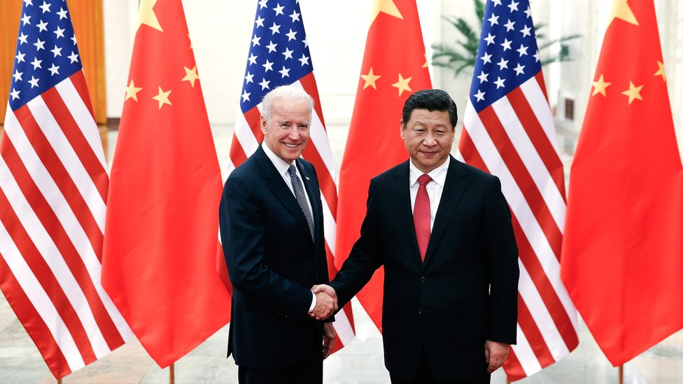 BEIJING, CHINA - DECEMBER 04: Chinese President Xi Jinping (R) shake hands with U.S Vice President Joe Biden (L) inside the Great Hall of the People on December 4, 2013 in Beijing, China. U.S Vice President Joe Biden will pay an official visit to China from December 4 to 5. (Photo by Lintao Zhang/Getty Images)