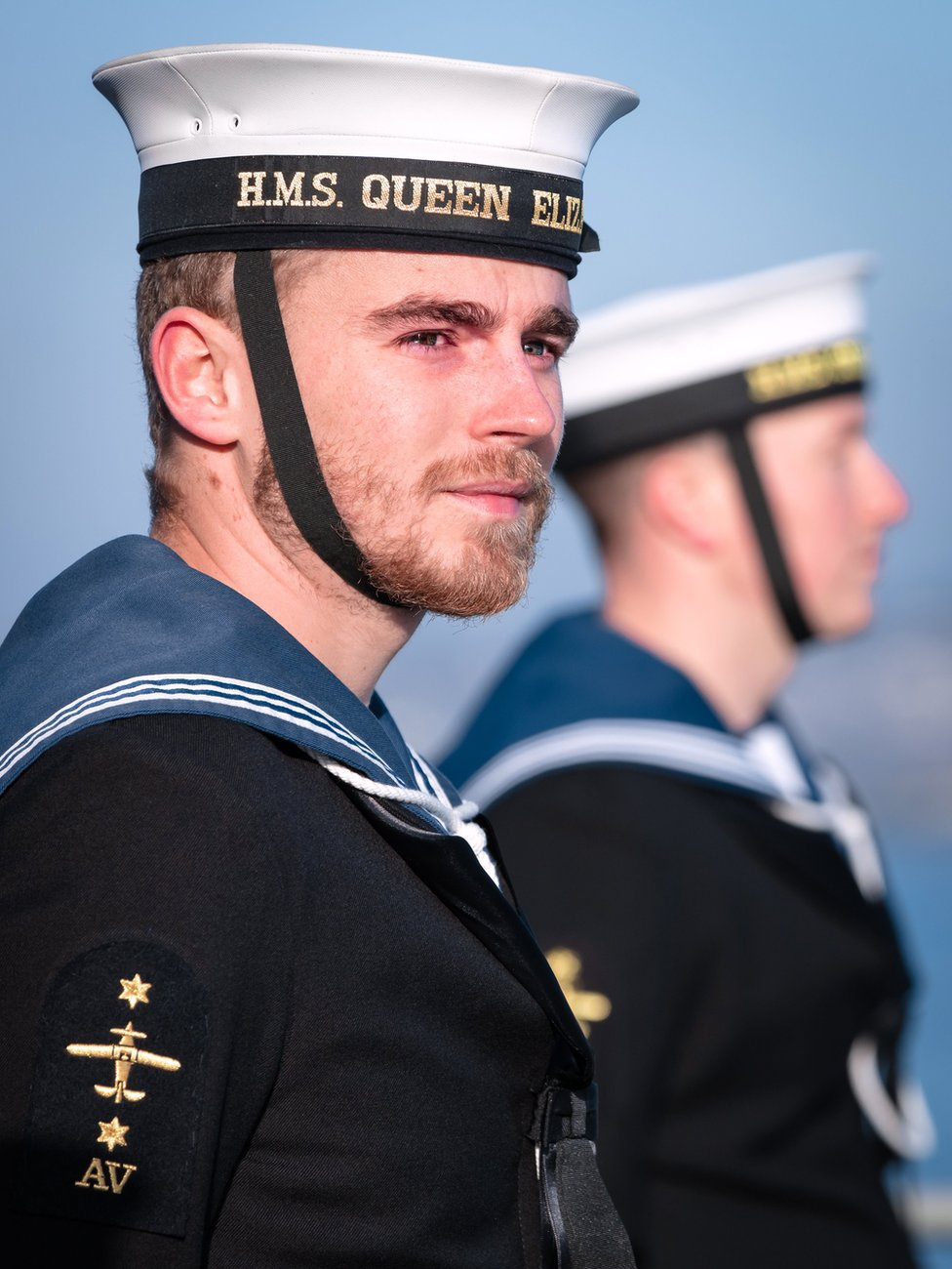 A sailor looks to the crowd