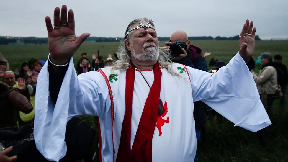 Arch-Druid Arthur Pendragon speaks in front of Stonehenge ancient stone circle, during the celebrations of the Summer Solstice, despite official events being cancelled amid the spread of the coronavirus disease