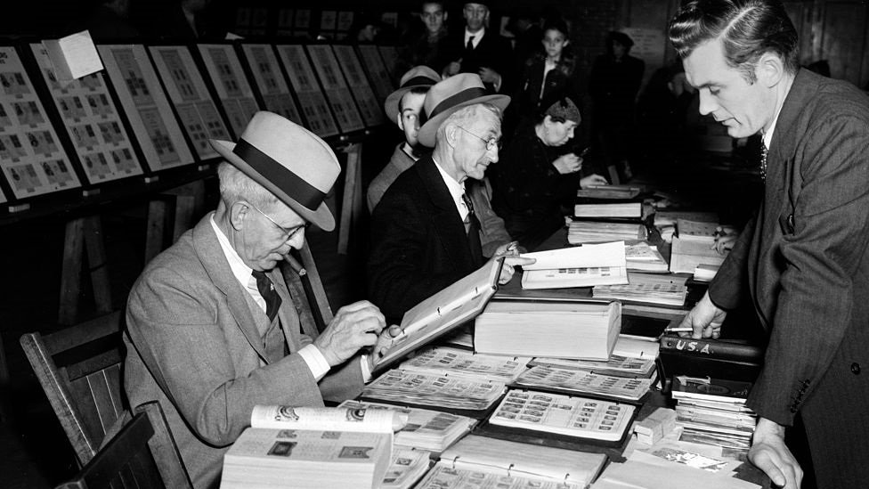 Stamp traders and dealers at a 1950s fair
