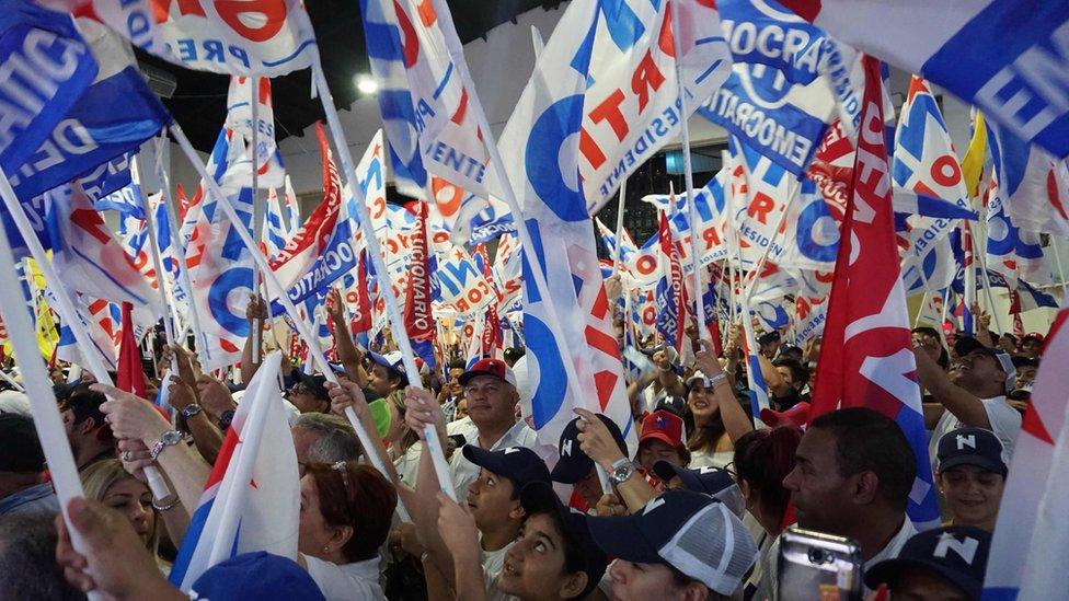 Supporters of Laurentino Cortizo celebrate at a rally
