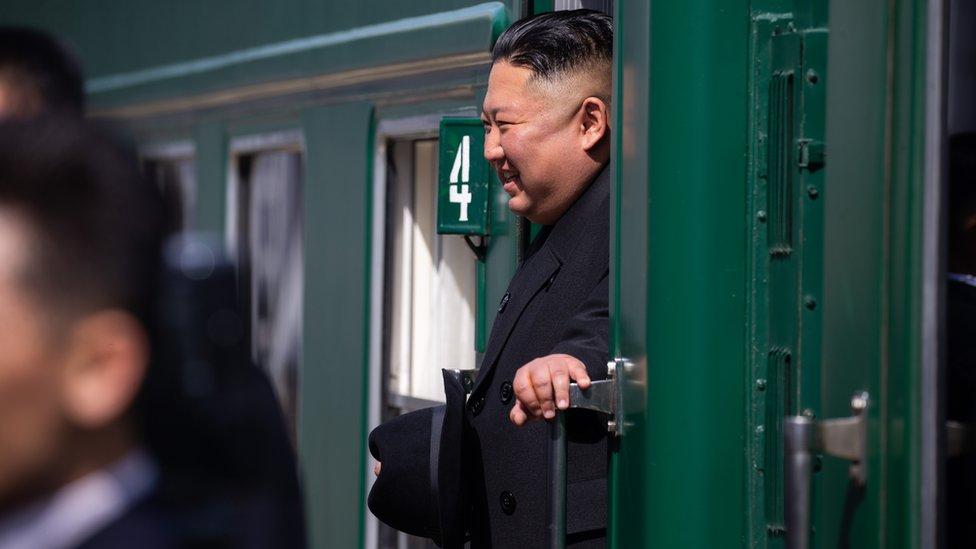Kim smiles on train