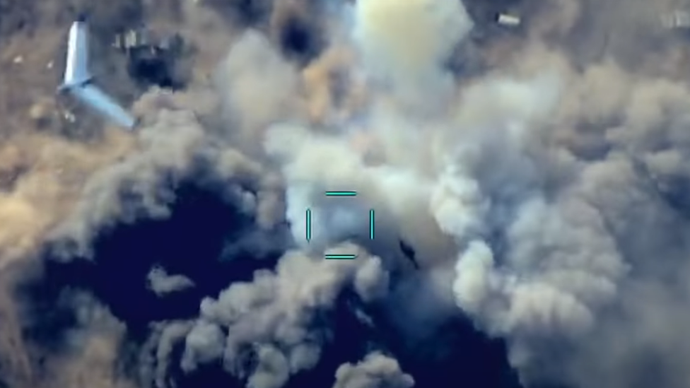 A drone attacking another drone flying above a target
