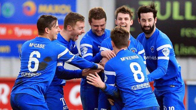 Ballinamallard players celebrate with Stephen O'Flynn who scored on his debut