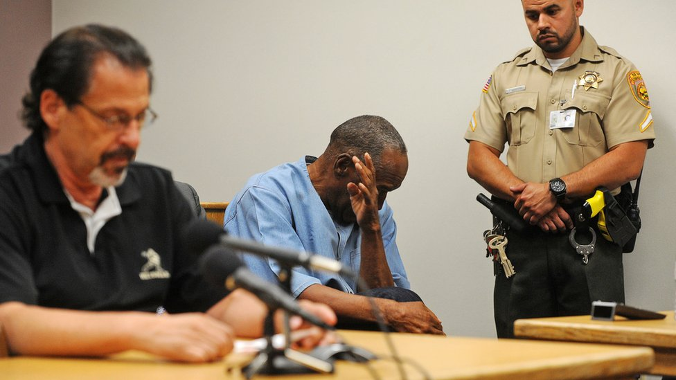 OJ Simpson (C) reacts during his parole hearing at Lovelock Correctional Centre in Lovelock, Nevada