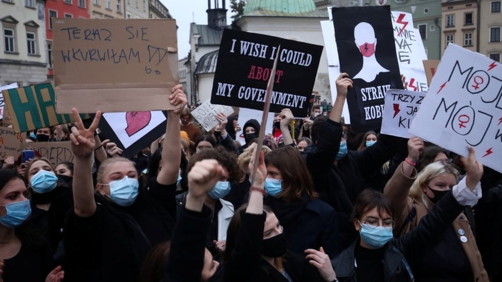 Demonstrators hold a protest against a court's near-total ban on abortion in Poland