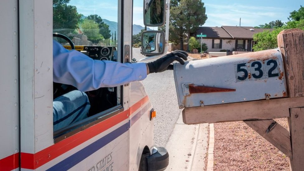 United States Postal Service mail carrier Frank Colon, 59, delivers mail amid the coronavirus pandemic on April 30, 2020 in El Paso, Texas.