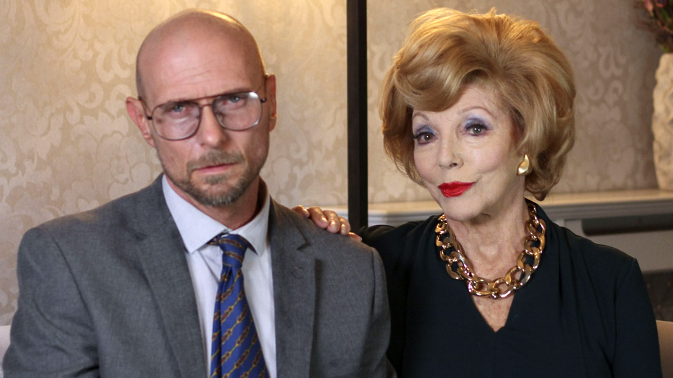 Luke Goss and Dame Joan Collins in The Loss Adjuster
