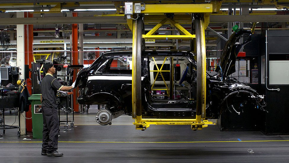 A worker at BMW's Mini factory in Oxford