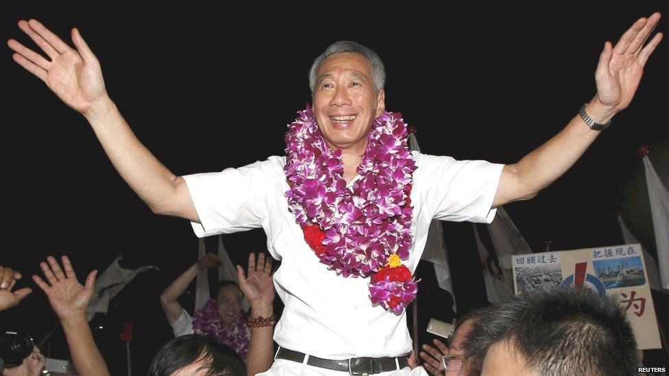 Singapore Prime Minister Lee Hsien Loong celebrates winning the general election