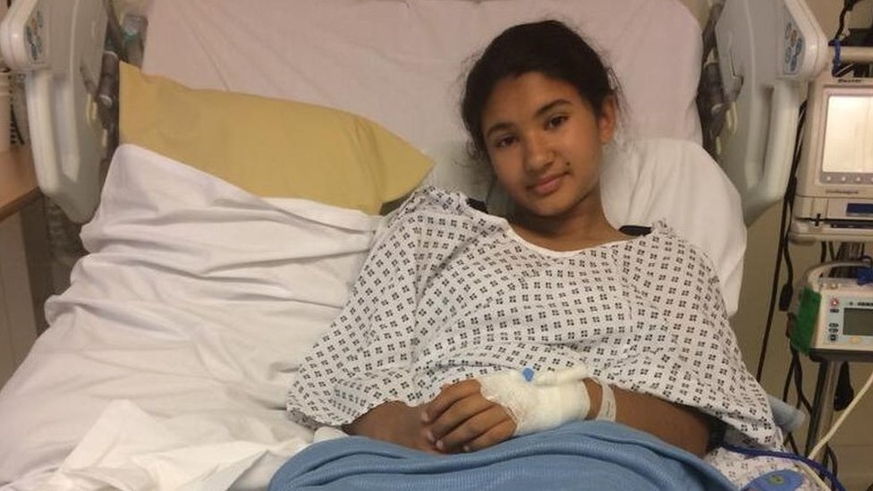 Arya Lloyd in a hospital bed