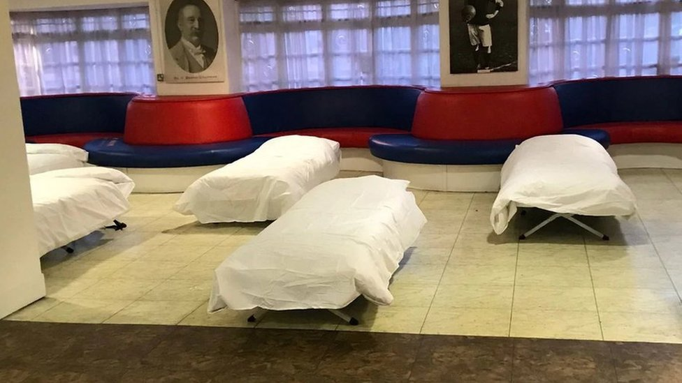 Freezing homeless sheltered by football club