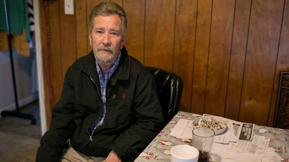 Leslie McCrae Dowless sitting in his home