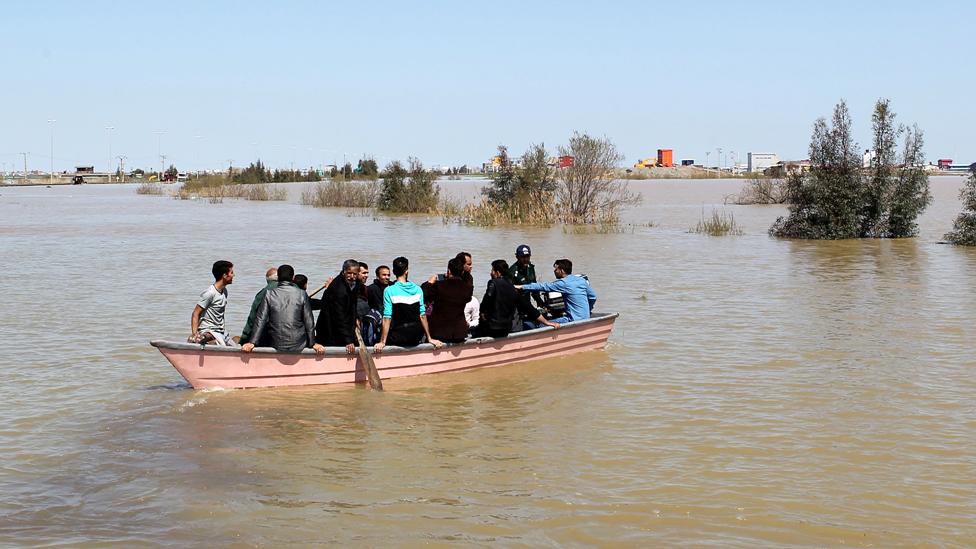 People in a boat in Golestan Province, Iran