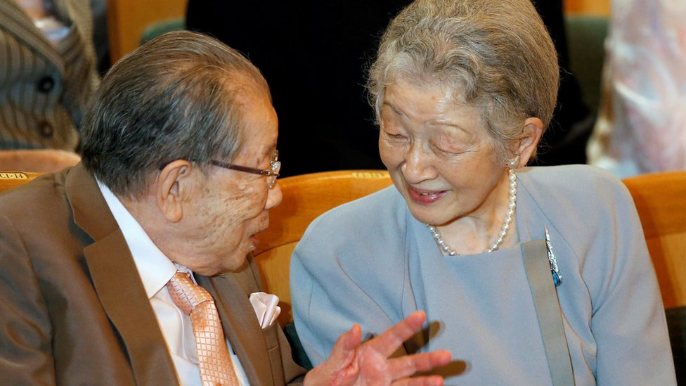 Japanese Empress Michiko (R) talks with physician Shigeaki Hinohara prior to a concert performed by South Korean tenor Bae Jae-chul in Tokyo, Japan, July 31, 2016