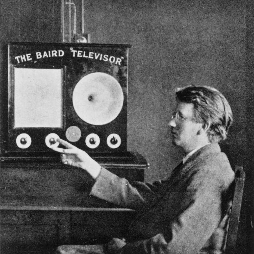 """John Logie Baird with his invention, the """"Televisor"""""""
