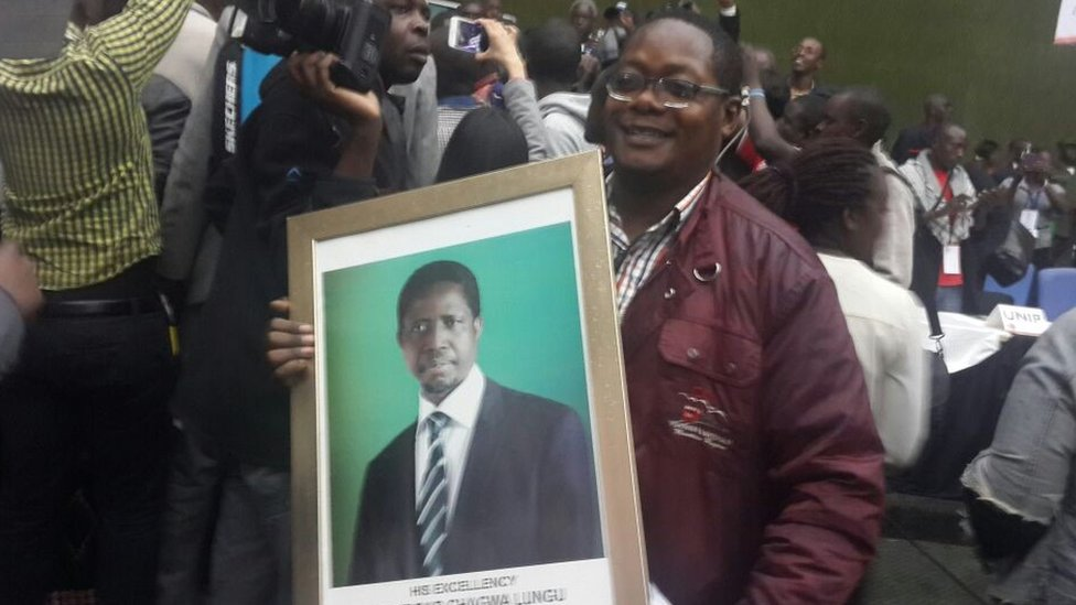 supporter hold a portrait of Edgar Lungu at electoral commission