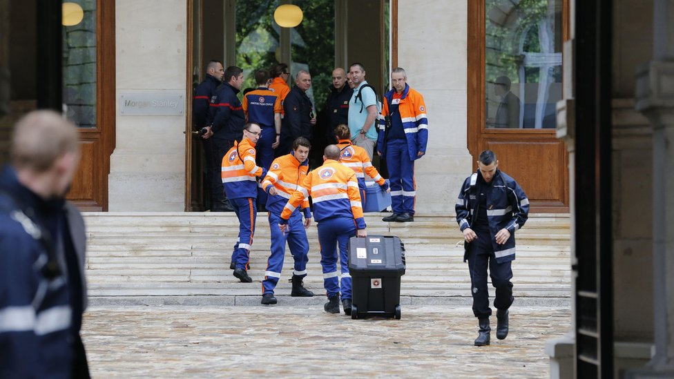 Emergency services work in a building near the Parc Monceau requisitioned to treat the injured (28 May)