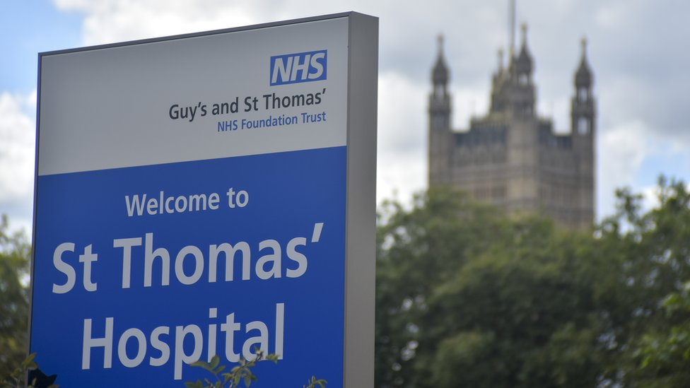 Signs of the NHS are pictured outside St. Thomas' hospital in central London on August 21, 2018.
