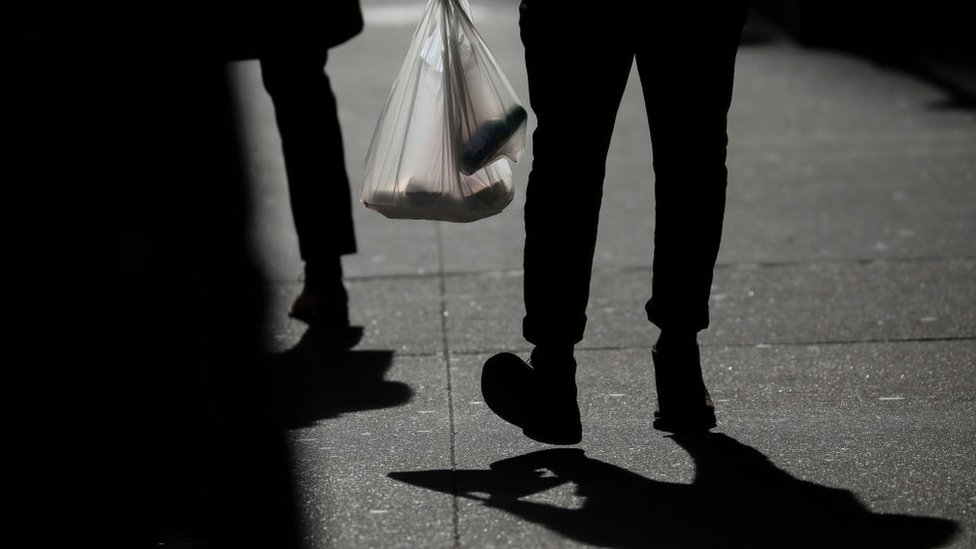 A person carries a plastic bag during the lunch hour in Lower Manhattan, January 15, 2019 in New York City