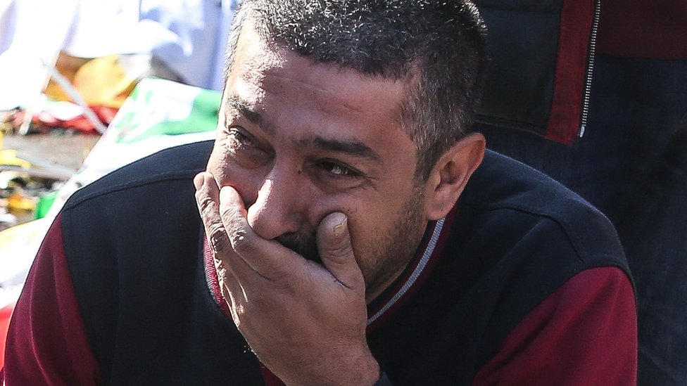 A man cries at the scene of explosions in Ankara, Turkey, Saturday 10 October 2015