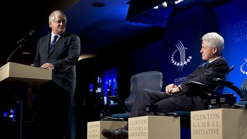 Bill Clinton listens as Digicel head Dennis O'Brien speaks at a Clinton Initiative event.
