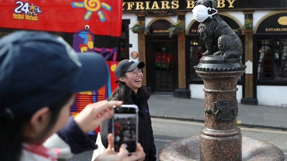 Tourists with Greyfriars Bobby