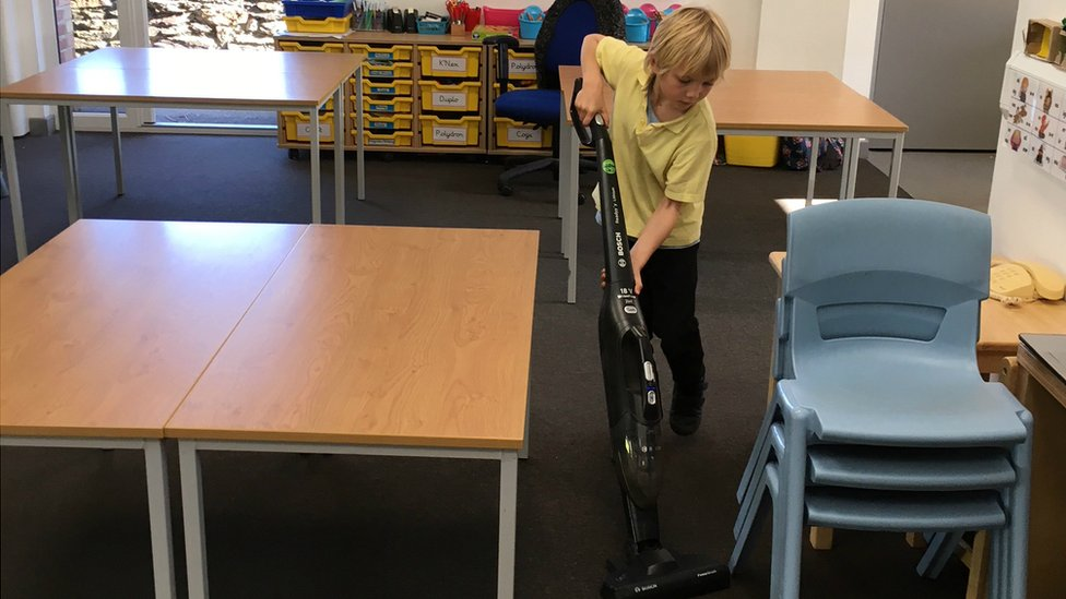 Children clean classrooms to save a Devon school money