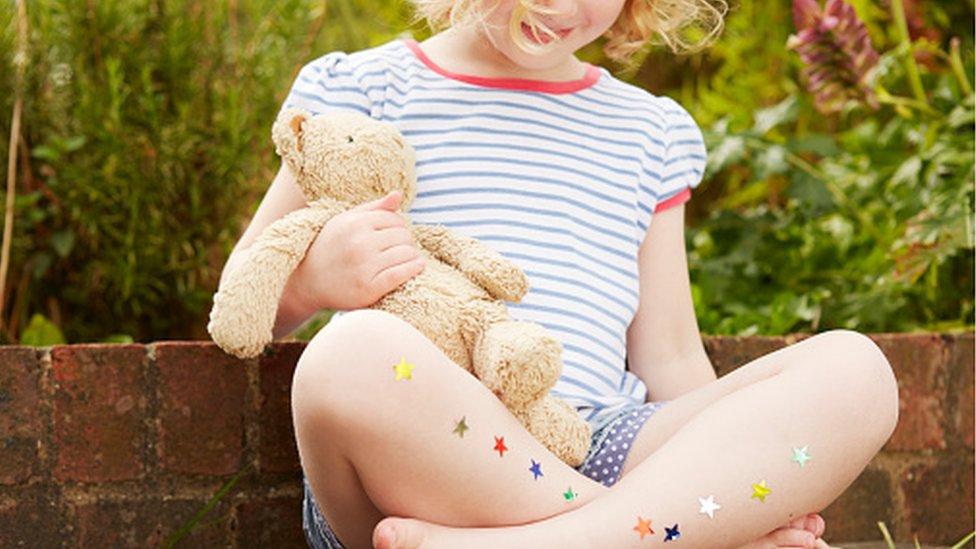 A child holding a teddy bear