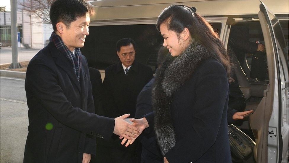 Hyon Song-wol is greeted by a South Korean official as she arrives at the South's CIQ (Customs, Immigration and Quarantine), just south of the demilitarised zone separating the two Koreas, in Paju, South Korea, on 21 January 2018