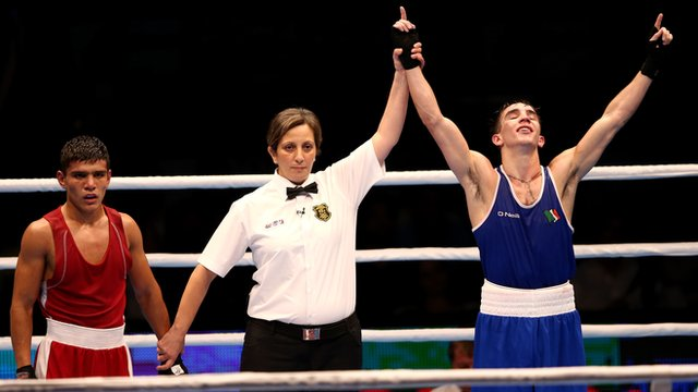 Michael Conlan, (RIGHT) becomes Ireland's first male World Boxing Champion after beating Murodjon Akhmadaliev, (LEFT) at the World Championships 56kg final in Doha.