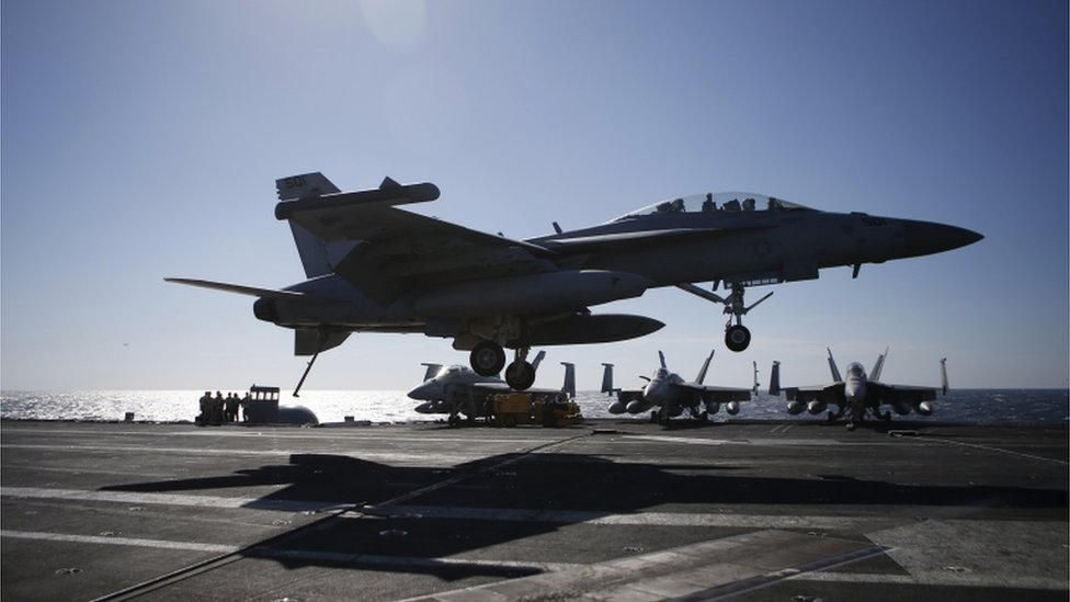 A US Navy F/A-18 Super Hornet fighter lands onto the deck of the USS Ronald Reagan, a Nimitz-class nuclear-powered super carrier, during a joint naval drill between South Korea and the US in the West Sea, South Korea, Wednesday, 28 October 2015