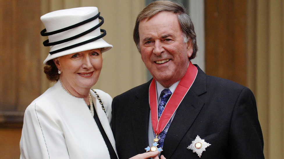 Sir Terry Wogan with his wife Lady Helen, after collecting his Knighthood