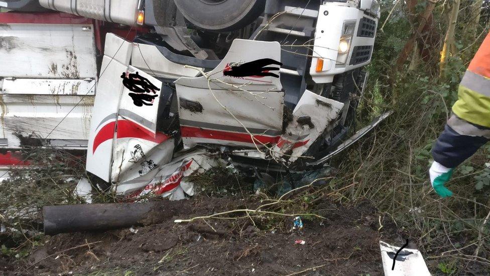 Upturned lorry