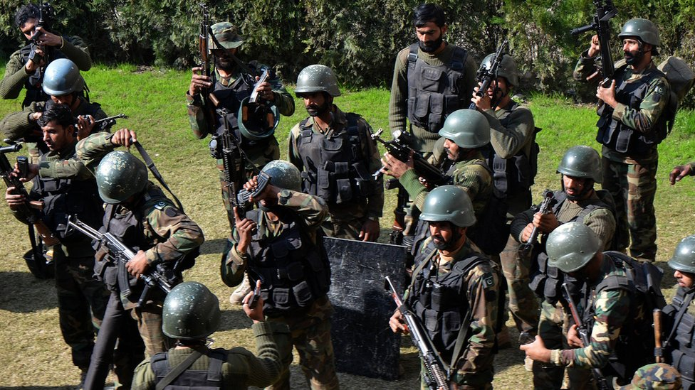 Pakistani army soldiers take part in a search operation at the Bacha Khan university following an attack by militants in Charsadda