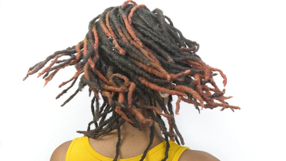 A woman with dreadlocks - generic shot