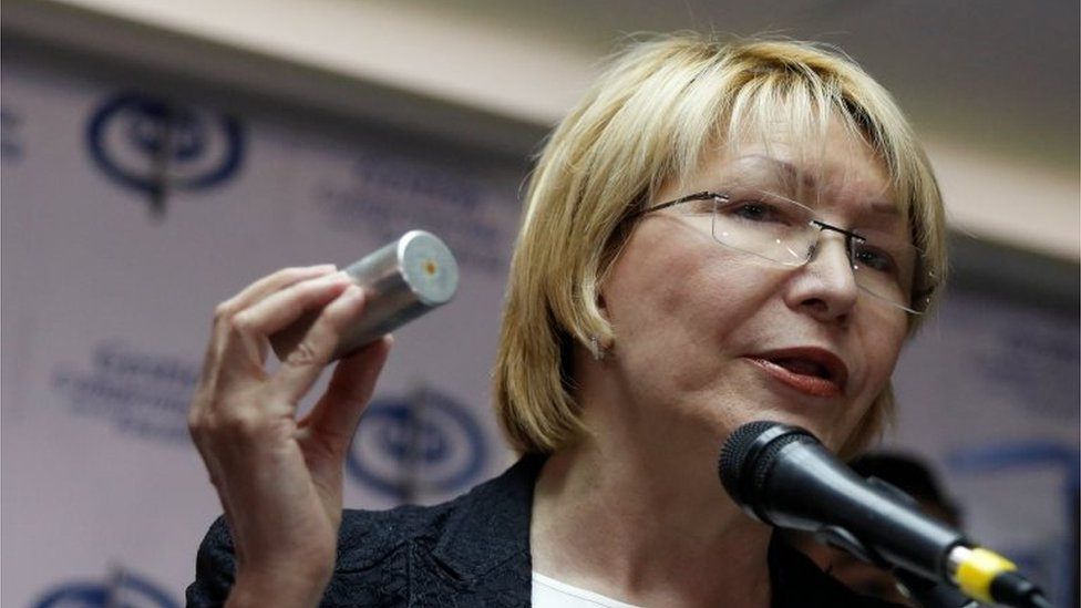 Venezuela's chief prosecutor Luisa Ortega Diaz holds a tear gas canister as she talks to the media during a news conference in Caracas, Venezuela May 24, 2017