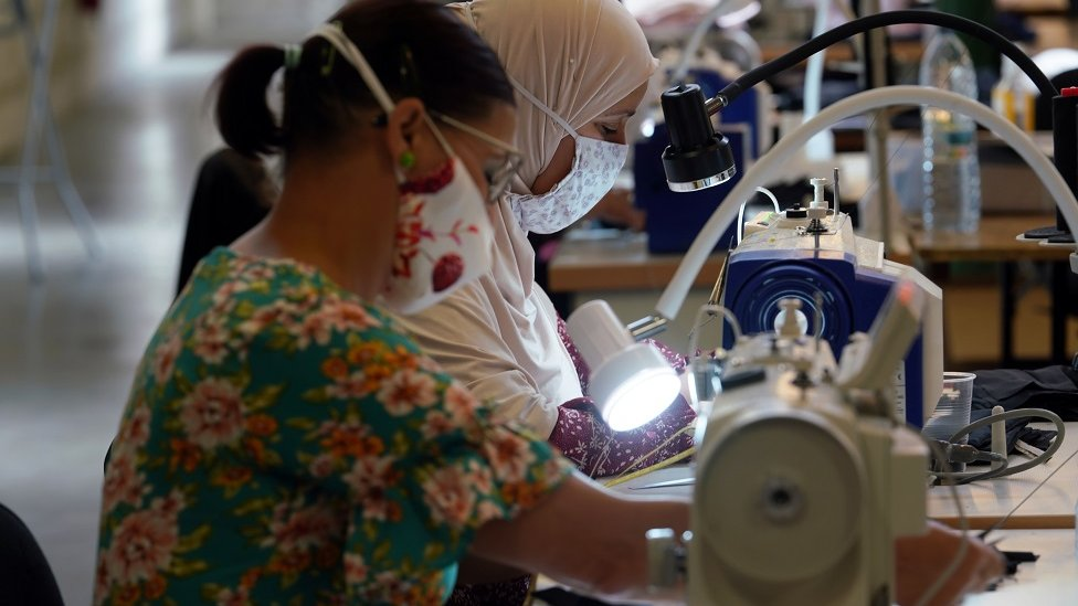 Workers inside a face masks factory in Roubaix, near Lille, as part of the visit of French Prime Minister Jean Castex on 3 August 2020 in Lille, France.