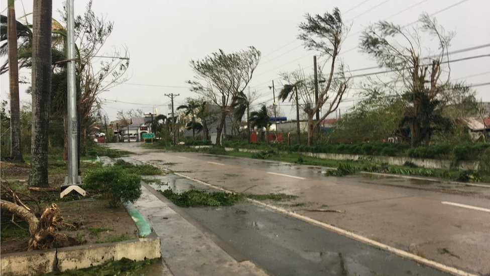 Storm damage and flooded road in Tuguegarao