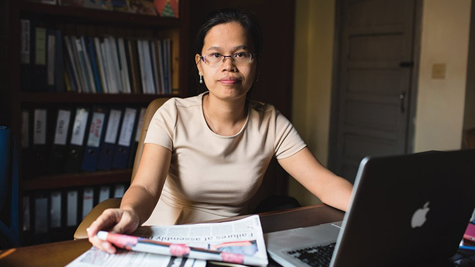 Chak Sopheap director from the Cambodian centre for human rights sits behind her desk