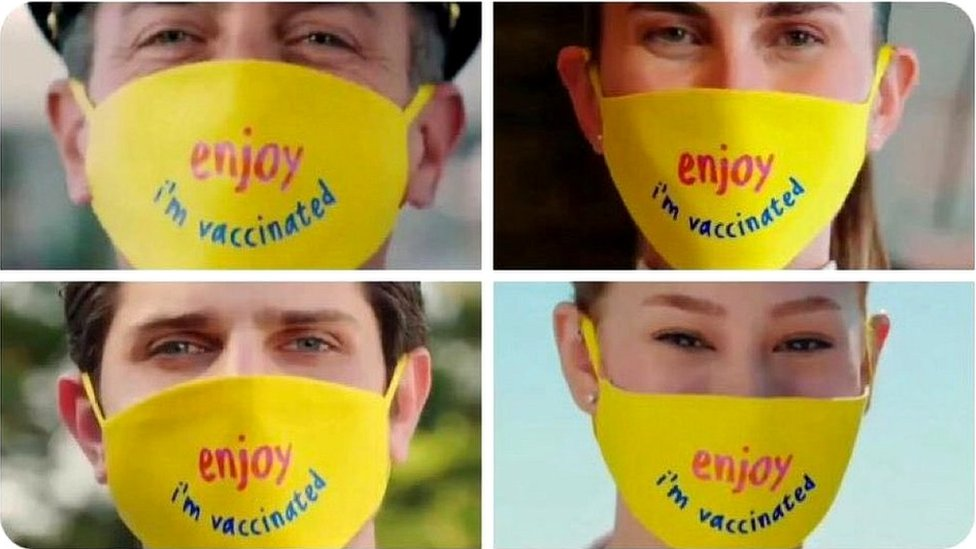 Yellow masks with 'Enjoy, I am vaccinated' written on them