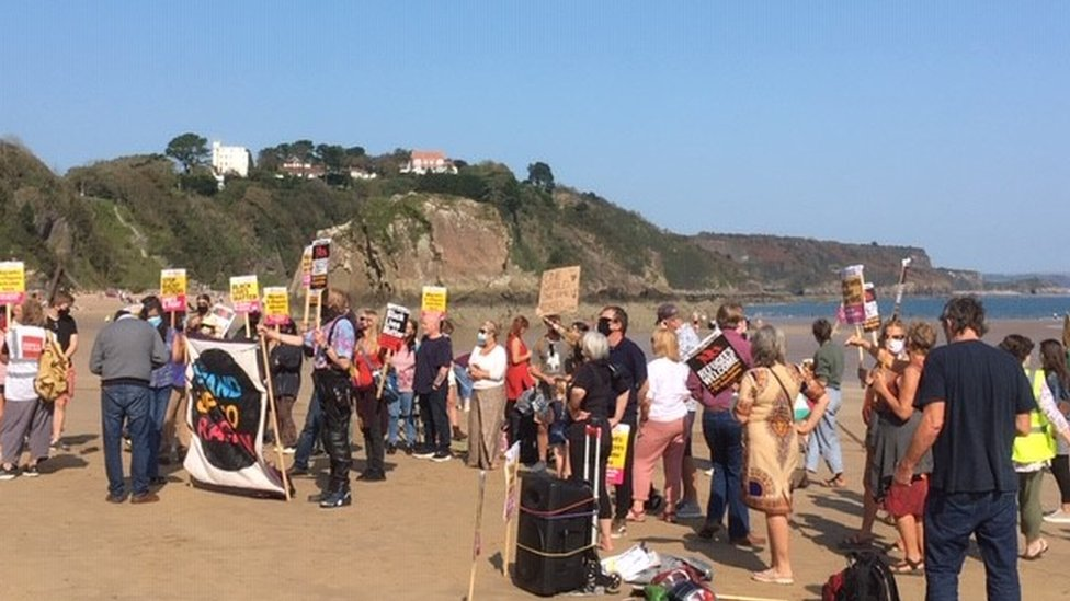Protestors on a beach in Tenby