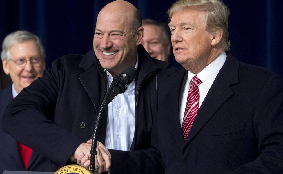 US President Donald Trump shakes hands with Gary Cohn, Director of the National Economic Council, on January 6, 2018