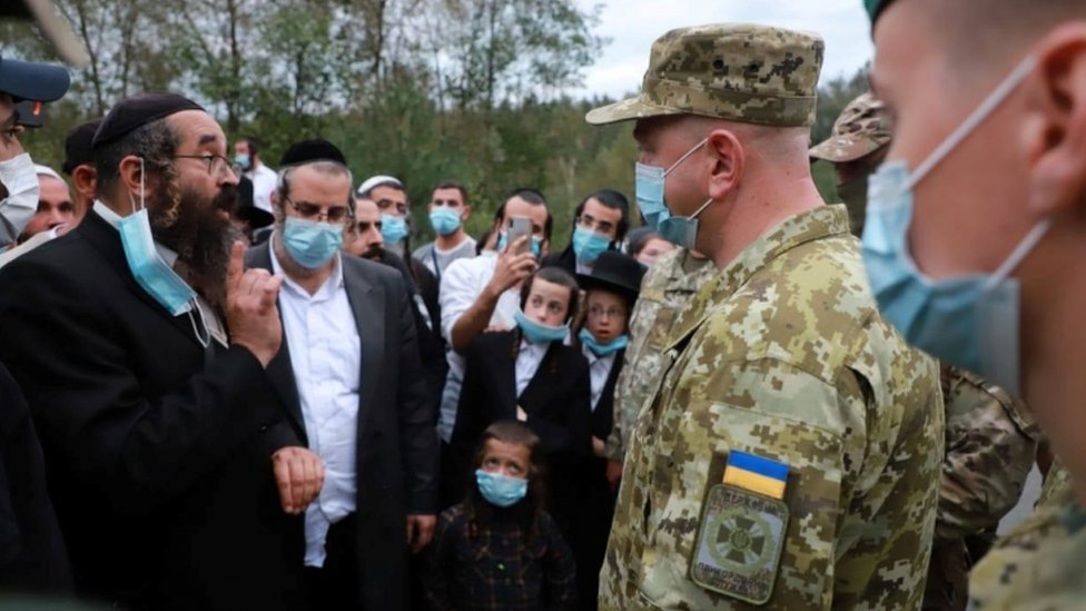 Ukraine's border service head Serhiy Deyneko speaks with Jewish pilgrims
