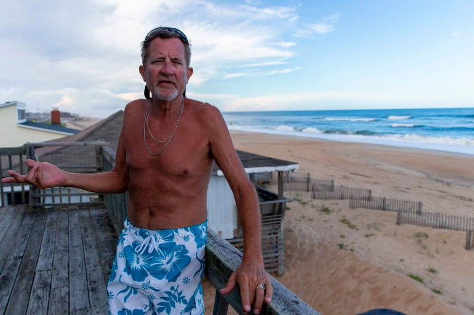 A vacationer from Ohio tells Getty News he plans to ride out the storm from his rental condo at North Carolina's Outer Banks
