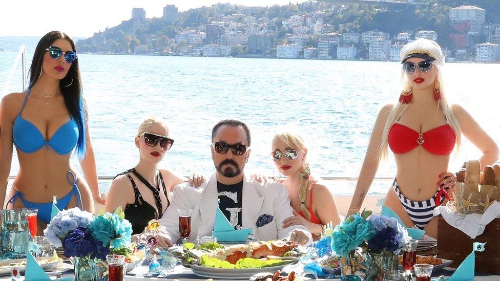 Adnan Oktar posing on a terrace by the Bosphorus in Istanbul